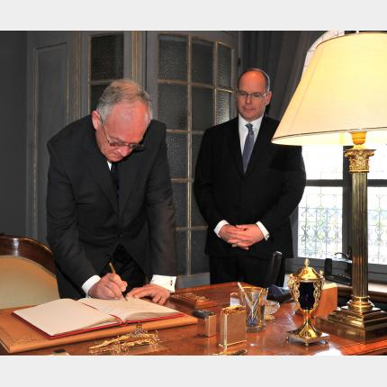 H.E. M. Michel Roger takes the oath of allegiance.
